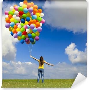 Vinyl-Fototapete Mädchen mit bunten Luftballons