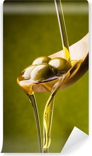 Vinyl-Fototapete Olivenöl mit grünem Hintergrund