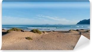 Vinyl-Fototapete Panoramablick auf den Strand von Famara, Lanzarote