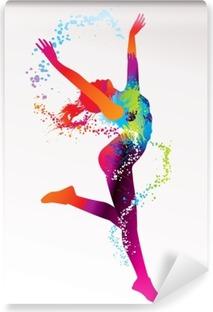 Fototapet av Vinyl Den dansande flicka med färgglada prickar och stänk på en ljus bac