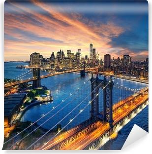 Fototapet av Vinyl New York City - solnedgång över Manhattan och Brooklyn Bridge