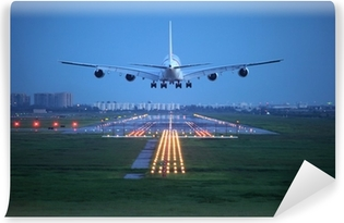 Passagerfly flyver over startbanen fra lufthavnen Vinyl fototapet