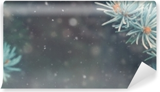 Fototapet av Vinyl Snö faller i vinterskogen. jul nyår magi. blå gran gran gren detaljer. banner image