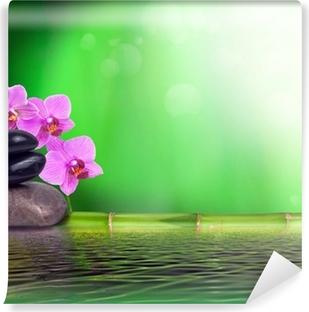 Fototapet av Vinyl Stilleben gjord av bambu, orkidé och sten