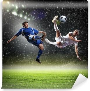 Fototapet av Vinyl Två fotbollsspelare slog till på volley