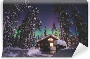 Fototapet av Vinyl Vacker bild av massiva flerfärgad grön levande Aurora Borealis, Aurora Polaris, även känd som norrsken på natthimlen under vintern Lappland landskap, Norge, Skandinavien