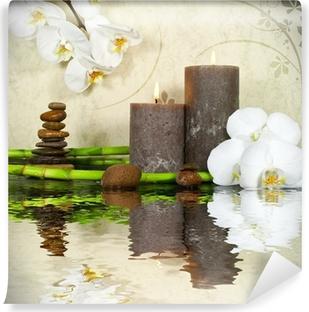 Fototapet av Vinyl Vit orkidé med bambu och ljus och sten