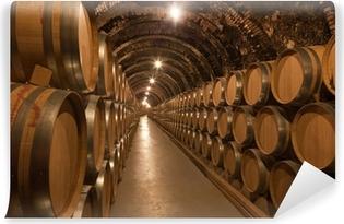 Fototapeta winylowa Beczki wina w piwnicy