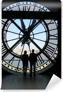 Vinylová Fototapeta Dva lidé, ozářená obrovské hodiny