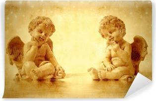 Fototapeta winylowa Dwie śliczne anioły siedzą