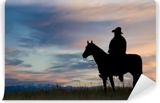 Vinylová Fototapeta Kovboj na koni, silueta proti jitřní oblohy