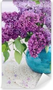 Vinylová Fototapeta Krásné fialové květy v tyrkysové váze