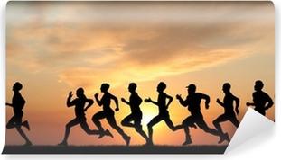 Vinylová Fototapeta Marathon, černé siluety běžců na západ slunce
