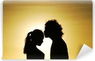 Vinylová Fototapeta Milující pár líbání silueta při západu slunce