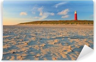 Vinylová Fototapeta Přímořské s písečnými dunami a maják při západu slunce