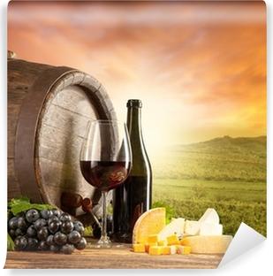 Fototapeta samoprzylepna Czerwone wino martwa natura z winnicy na backgorund