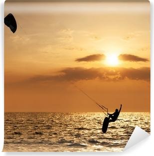 Fototapeta samoprzylepna Kite surfer skakanie z wody