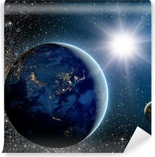 Fototapeta samoprzylepna Wschód słońca nad planety i satelity w przestrzeni.