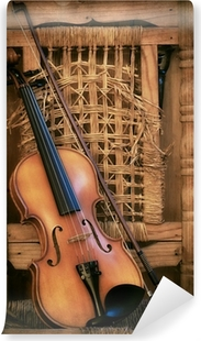 Vinylová Fototapeta Staré housle ležící na zničené židli