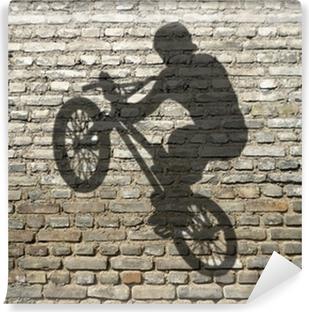 Vinylová Fototapeta Stín muže v BMX na cihlové zdi