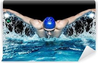 Vinylová Fototapeta Svalová mladý muž v modré čepici do bazénu