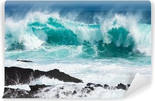 Vinylová Fototapeta Tyrkysová válcování vln slaming na skalách
