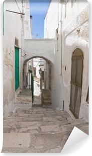 Fototapeta winylowa Uliczka. Ostuni. Puglia. włochy.