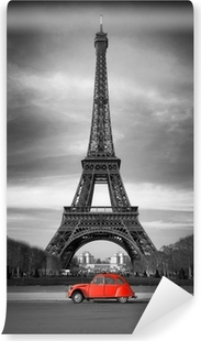 Fototapeta winylowa Wieża Eiffla i czerwony-paris samochód