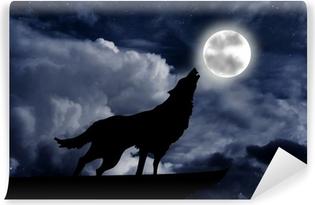 Fototapeta winylowa Wilk wyje do księżyca w pełni