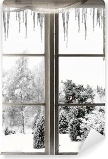 Fototapeta winylowa Zimowy krajobraz oglądany przez okno