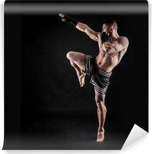 Fototapeta zmywalna Sportowiec akcja bokser intensywny portret na czarnym tle.