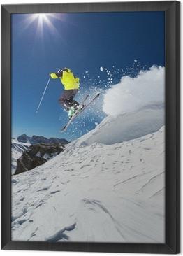 Alpine skier jumping from hill Framed Canvas