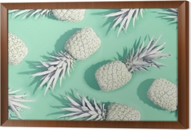 Painted pineapples on a pastel green background Framed Canvas