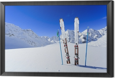 Ski, winter season , mountains and ski equipments Framed Canvas