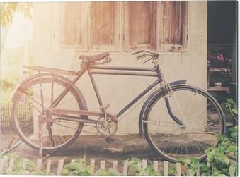 Glasbild Weinlese-Fahrrad oder altes Fahrrad Vintage Park auf alten Mauer nach Hause.
