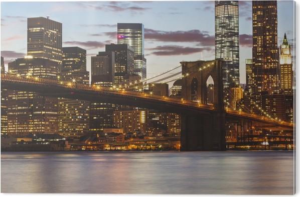 Impressão em PVC Brooklyn Bridge and Downtown Skyscrapers in New York at Dusk - América do Norte