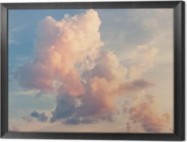 Ingelijst Canvas Roze wolken tegen een blauwe lucht