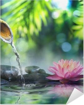 Zen-puutarha, jossa on mustat kivet ja vaaleanpunainen waterlily Itsestäänkiinnittyvä Juliste