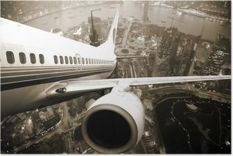 Lentokone siirtyy kaupungin yöstä. Juliste