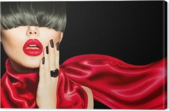 Huippumuotoinen tyttö, jossa on trendikäs kampaus, meikki ja manikyyri Kangaskuva