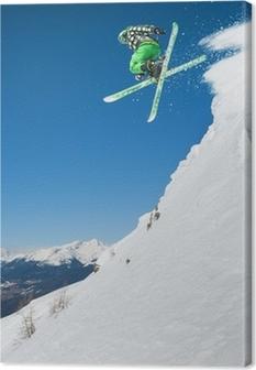 Hyppää hiihtäjä vuoristossa Kangaskuva