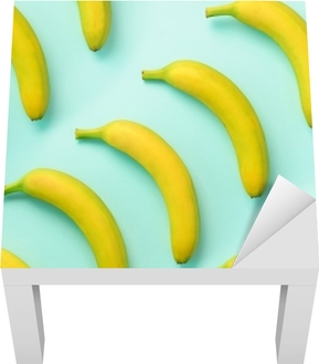 Colorful fruit pattern. Bananas over blue background. Top view. Pop art design, creative summer concept. Minimal flat lay style. Lack Table Veneer