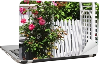 White arbor with red blooming roses in a garden Laptop Sticker