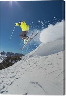 Leinwandbild Alpine Skifahrer springt von Hügel