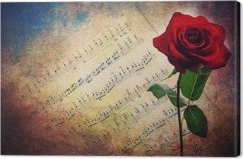 Leinwandbild Antique Partitur mit roten Rose