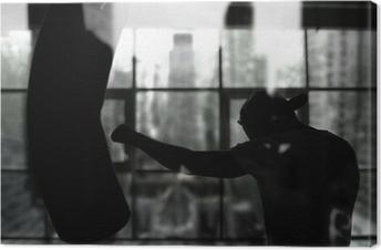 Leinwandbild Boxer schlägt einen Boxsack gegen das Fenster, Training