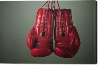 Leinwandbild Boxhandschuhe hängen von Schnürsenkel auf einem grauen Hintergrund