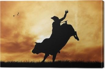 Leinwandbild Bull Fahrer bei Sonnenuntergang