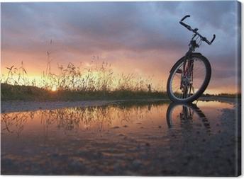 Leinwandbild Fahrrad in der Pfütze