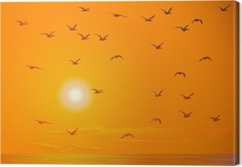 Leinwandbild Fliegende Vögel gegen orange Sonnenuntergang.